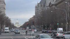 The United States Capitol building and traffic street by day, Washington DC, USA Stock Footage