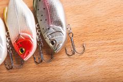 Bait for fishing - wobbler on light wood Stock Photos