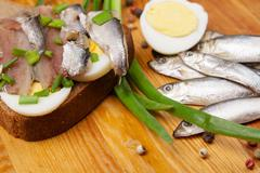 sandwich from salted anchovies with egg and spring onion - stock photo