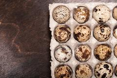 many fresh speckled quail eggs in cardboard container - stock photo