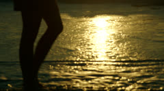 Tilt up on woman turning to ocean sunrise horizon longfocus, 48fps -CC -lev Stock Footage