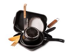 heap of kitchen bakeware with pan and pot - stock photo