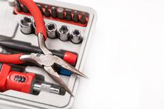 open toolbox with screwdriver, heads and bit - stock photo