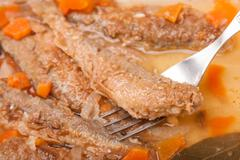juicy snack a roast pickled smelt with carrot - stock photo