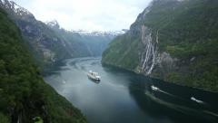 Cruise Ship passing Ferry in Geirangerfjord Stock Footage