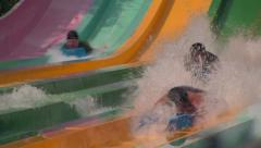 Water Slide Action Close-up with People Splashing Stock Footage