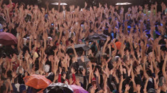 Crowd at the concert claps hands in the sign language - stock footage