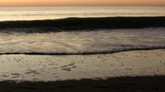 Surf breaks at dawn, 60fps Stock Footage
