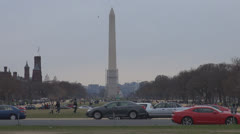 The Washington Monument and Smithsonian Castle in cloudy day, Washington DC, USA Stock Footage