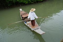 Fisherman at mangrove forest Stock Photos