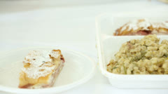 Strudel with other prepared dishes sliding over - stock footage