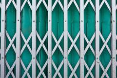 Green steel shutter gate Stock Photos