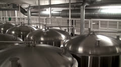 Modern Craft Brewery. Steel fermentation vessels. - stock footage