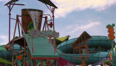 Big Bucket of Water Spilling at Water Park's Kids Play Area Stock Footage