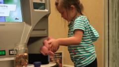 Little Girl Emptys her Piggy bank Stock Footage
