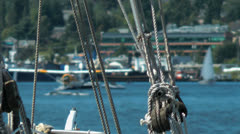 Float plane behind boat rigging - stock footage