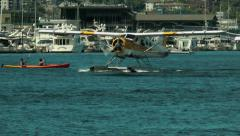 Float plane and kayak on lake - stock footage