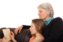 Stock Photo of grandmother read a book with her granddaughter