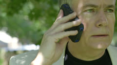 Closeup of businessman on a cell phone Stock Footage