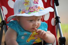Infant girl in stroller Stock Photos