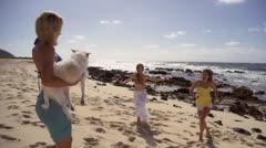 Hawaii -beautiful women hugging dog on beach-240fps - stock footage