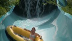 Action Shot of a Person Speeding Down a Water Slide in a Big Tube Stock Footage