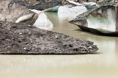 tasman glacier lake icebergs in aoraki mt cook np - stock photo