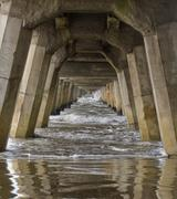 concrete foundation pilings of tolaga bay wharf nz - stock photo