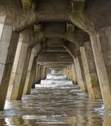 Concrete foundation pilings of tolaga bay wharf nz Stock Photos