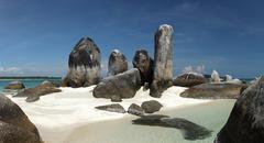 batu berlayar island with natural rock formation - stock photo