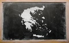 outline map of greece on blackboard - stock illustration