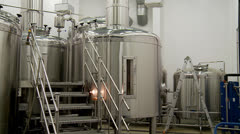 Large steel vats (Kettles) in the brewhouse of a brewery. Stock Footage