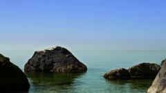 Calmness sea - wild rocky coastline - stock footage