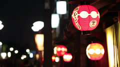 Gion is an oldest district with red paper lanterns on house, Kyoto, Japan Stock Footage