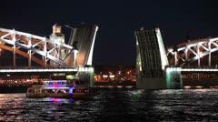 Pleasure boat for passing through opened the Bolsheokhtinsky Bridge, Russia Stock Footage