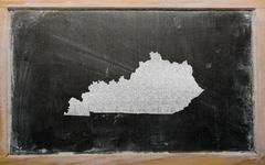 Outline map of us state of kentucky on blackboard Stock Photos