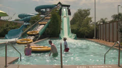 People on Big Tube Sloping Water Slide at Aquatica Water Park Stock Footage