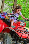 Young girl on a 4-wheeler atv Stock Photos