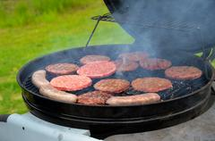 Stock Photo of Grilling hamburgers and bratwursts