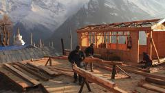 Workers build the house in highlands. Stock Footage