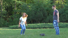 Happy young couple is having fun in the park Stock Footage