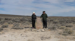 Wyoming South Pass monument rock couple in wind Stock Footage
