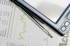 Graph and pda Stock Photos
