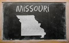 Outline map of us state of missouri on blackboard Stock Photos