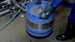 Filling (packaging) fresh beer in a beer kegs at a brewery. Stock Footage