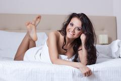 portrait of beautiful smiling brunette - stock photo