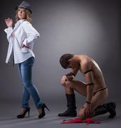 Pretty woman with naked guy posing in studio Stock Photos