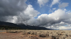Wyoming clouds over Tetons time lapse Stock Footage