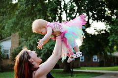 A happy mother and baby girl Stock Photos
