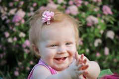 Baby girl clapping hands - stock photo